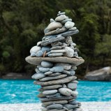 Haast-Pass-New-Zealand-adventure-hiking-stone-sculpture